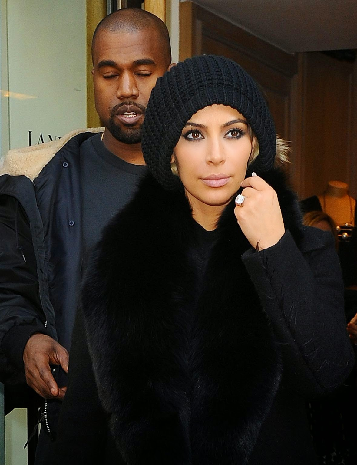 Kim Kardashian attempts to hide her new platinum locks