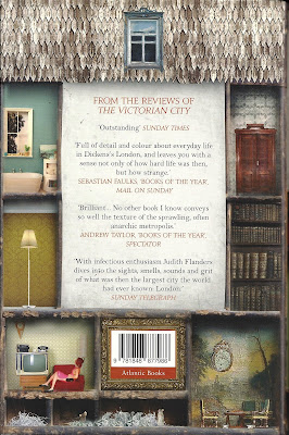 Back cover of a book, showing various miniature room settings.
