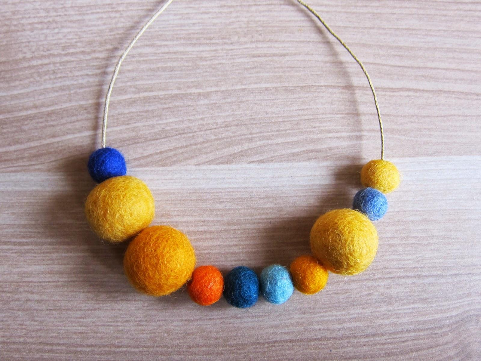 collar-bolas