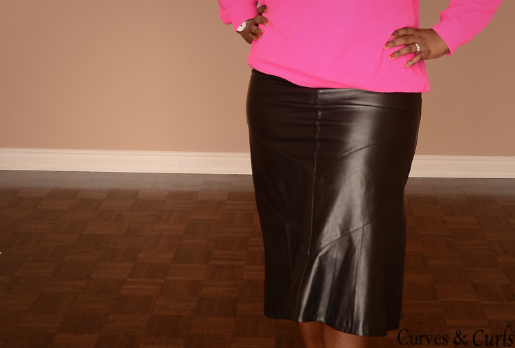 plus size fashion for women: bright pink sweater with leather skirt and animal print shoes