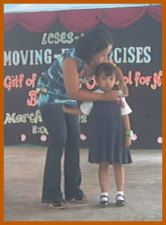 Mama Pinning Panie Ribbon of Recognition