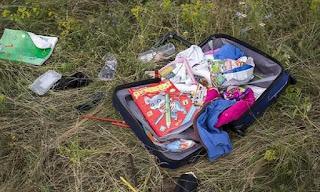 Pemberontak Russian Menggeledah Bag Penumpang MH17