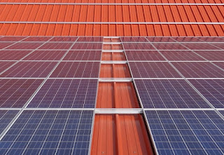Photo Voltaic Panels on Warehouse Rooftop