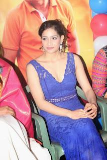 Komal Sharma Spicy Stills in Deep Neck Blue Gown from movie Vaigai Express Launch Event