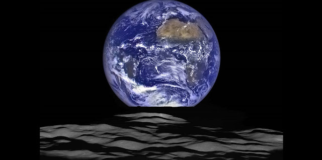 The Earth straddling the limb of the Moon, as seen from above Compton crater. Center of the Earth in this view is 4.04°N, 12.44°W, just off the coast of Liberia. The large tan area in the upper right is the Sahara desert, and just beyond is Saudia Arabia. The Atlantic and Pacific coasts of South America are visible to the left. WAC E1199291151C (Earth only), NAC M1199291564LR (Earth and Moon); sequence start time 12 October 2015 12:18:17.384 UTC [NASA/GSFC/Arizona State University].