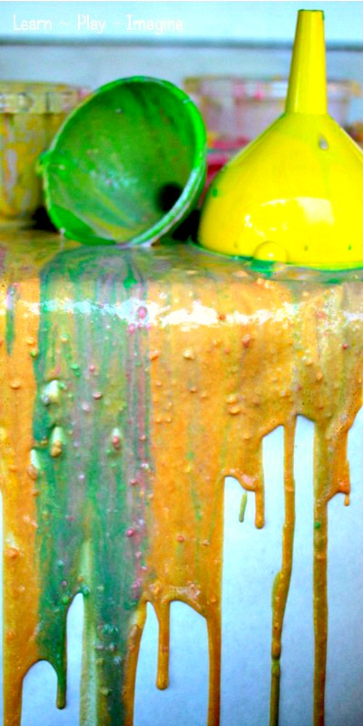 Beautiful and messy art for kids - pour painting with funnels!