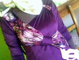 http://www.almaraaworld.com/2013/11/Mudalat-plush-purple-dresses.html