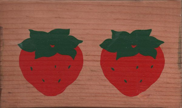 wooden postcard with 2 strawberries painted on it