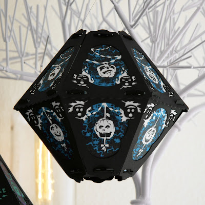 Signed Halloween art lantern by Bindlegrim features pumpkins in blue, white, and black