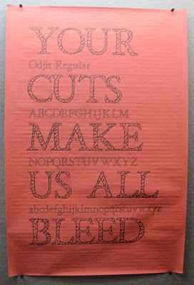 Sign reading Your cuts make us all bleed