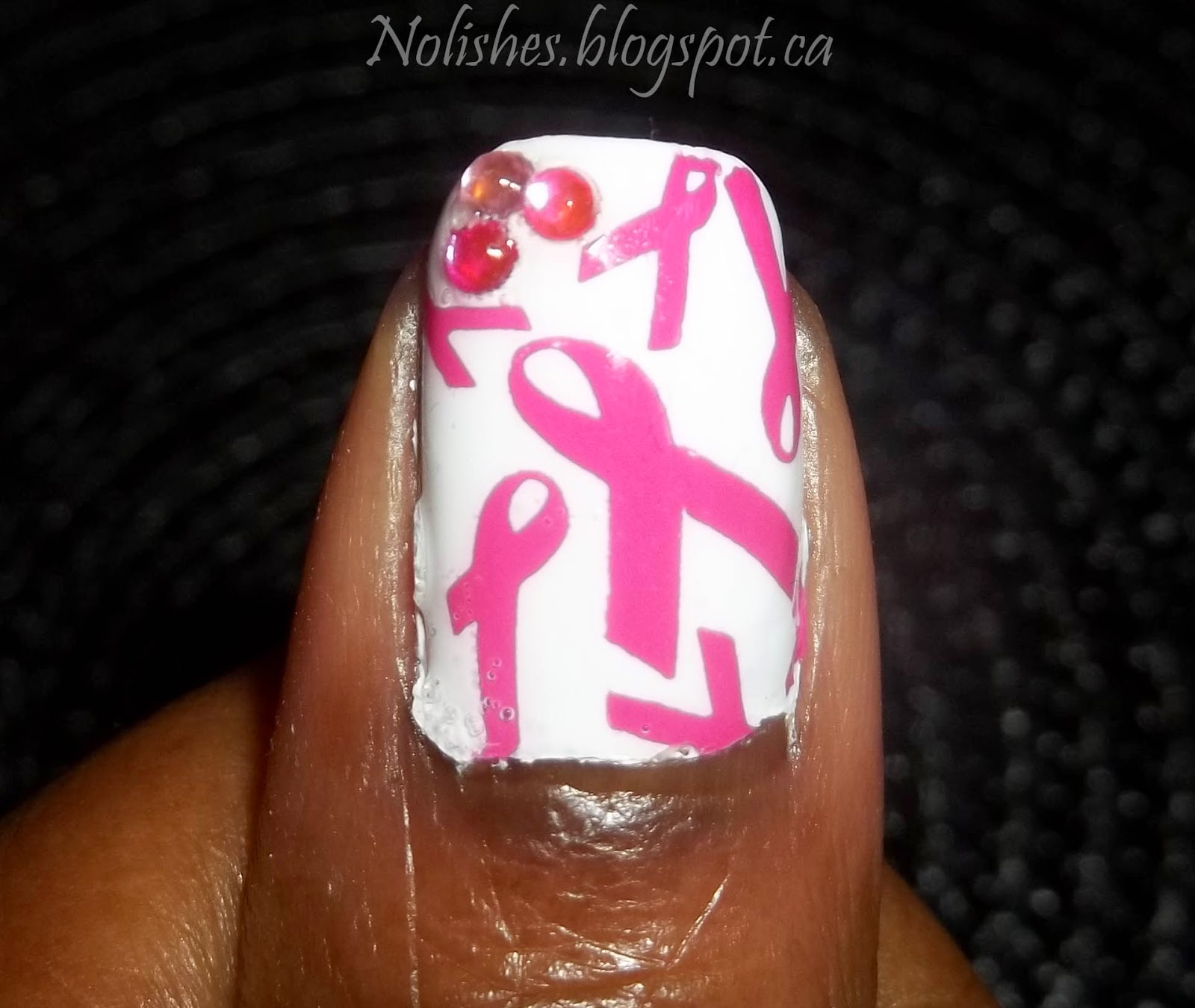 Pink and White Pink Ribbon Nail Stamping Manicure (Thumb Only) using Sally Hansen Insta-Dri 'Presto Pink' and China Glaze 'White on White' stamped with Bundle Monster BM-321. Also featuring a few nail art rhinestones in various shades of pink