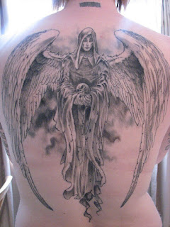 full-back tattoo: Angel of Death holding a human skull