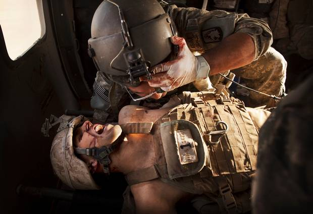 An injured Marine receiving care