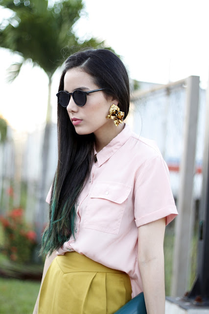 Lutfi Janania earrings and pastel pink blouse