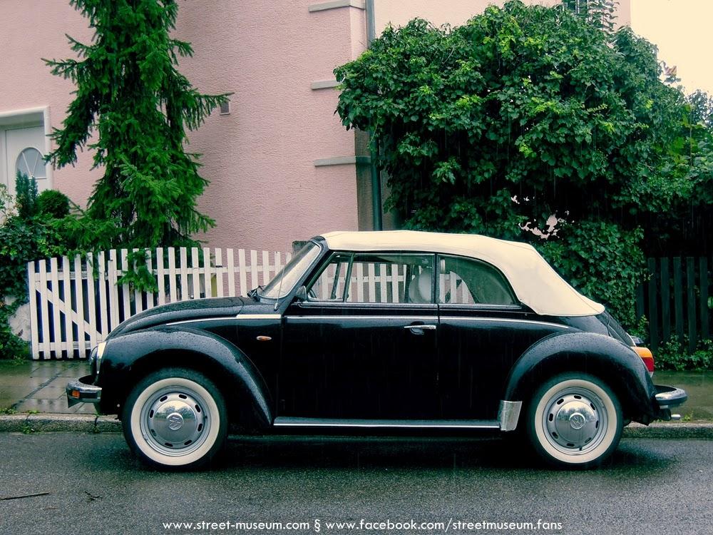 stuttgart black vw beetle karmann in rain street museum. Black Bedroom Furniture Sets. Home Design Ideas