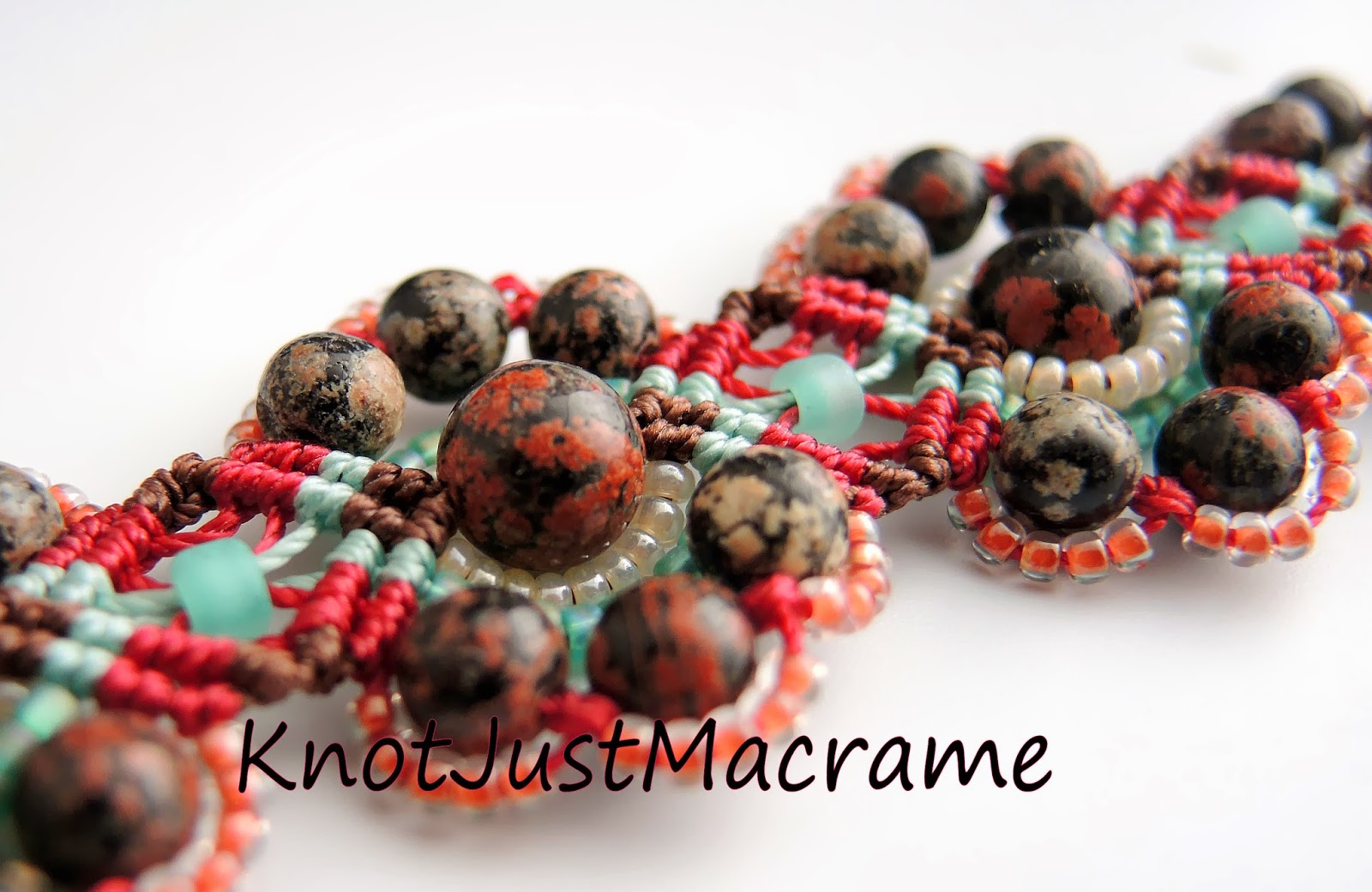 Mexican red snowflake jasper beads knotted in micro macrame with turquoise colored accents