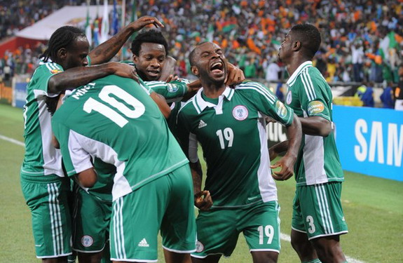 Nigeria player Sunday Mba celebrates his winning goal against Burkina Faso with his teammates