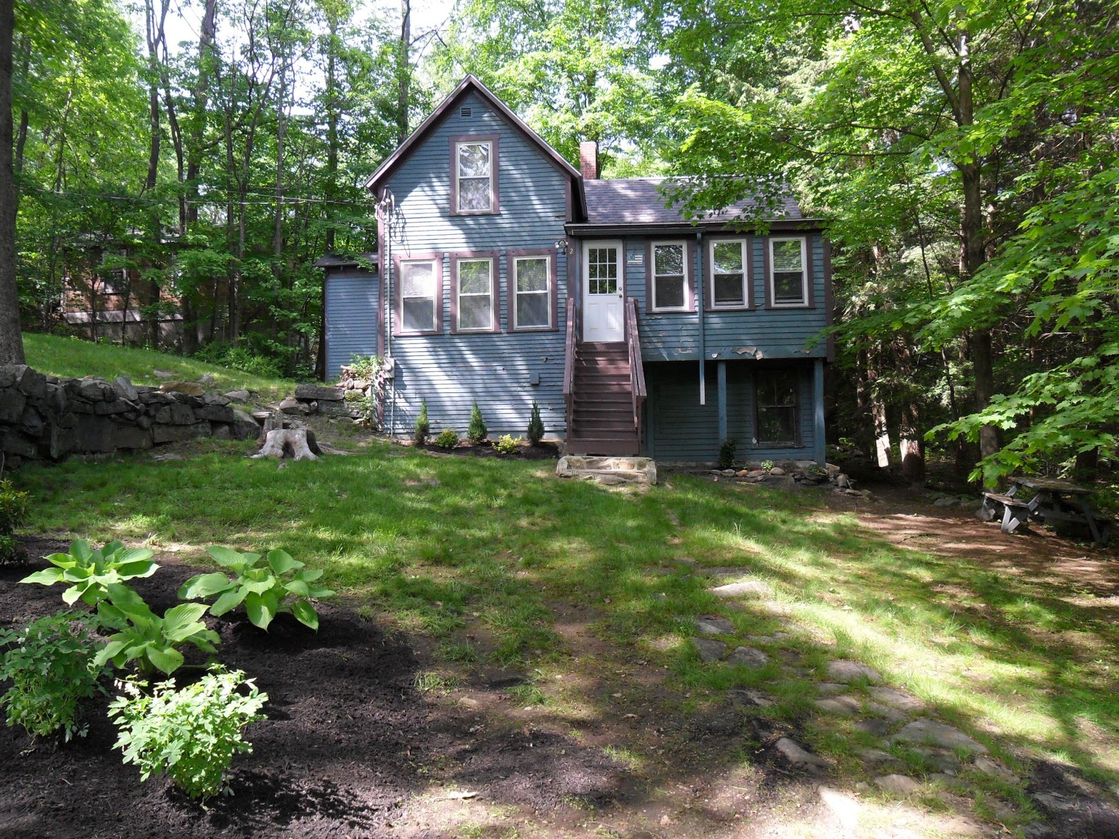loft & cottage: choosing exterior paint colors for the cabin