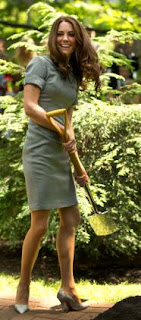 Kate smiles after lifting a spade of dirt during a tree planting ceremony at Rideau Hall in Ottawa, Ontario, as part of their Royal Tour of Canada Saturday, July 2, 2011