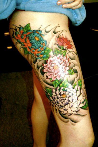 Marigold Flower Thigh Tattoo