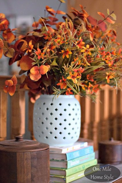 Fall flower arrangement in a light blue vase - One Mile Home Style Fall Home Tour