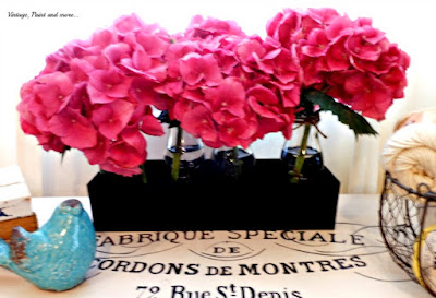 Vintage, Paint and more... Hydrangeas in twine wrapped milk bottles in a black chalk painted tin trough