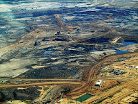 Alberta tar sands - An aerial view of the tar sands in Alberta, Canada. (Credit: Howl Arts Collective/Flickr) Click to Enlarge.