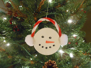 Snowman ornament from a plastic lid