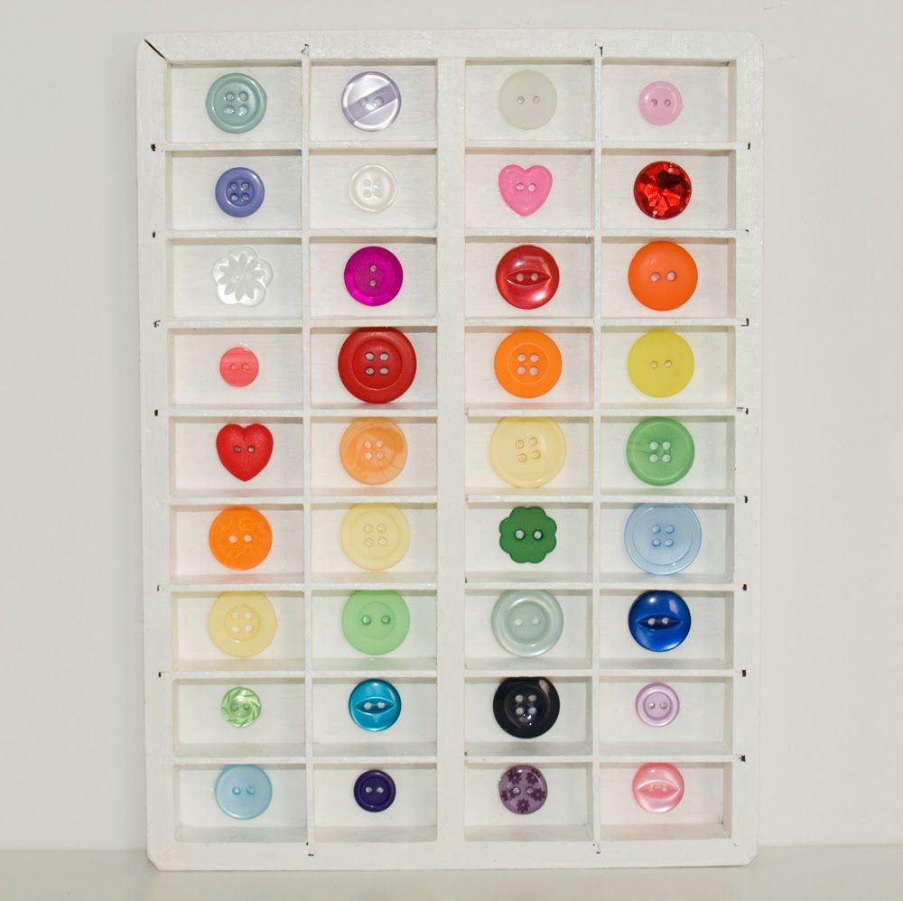 Multi coloured button tray