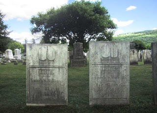 Two 19th century gravestones for two women, married to the same man