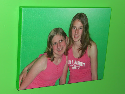 Picture of my raiser's canvas (her sister & her) hanging on her lime green wall