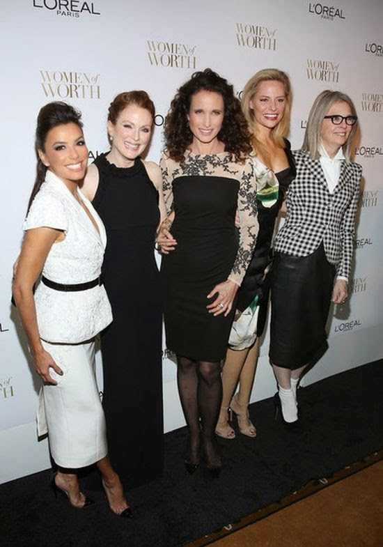 Not a single day was out of place to her polished up do, and Julianne Moore was content to kept her birthday party on Wednesday to more statuesque.  The modern style of a hugging long gown by Alexander McQueen went perfectly to the actress's midriff as she headed the event at New York, USA on Tuesday, November 2, 2014.