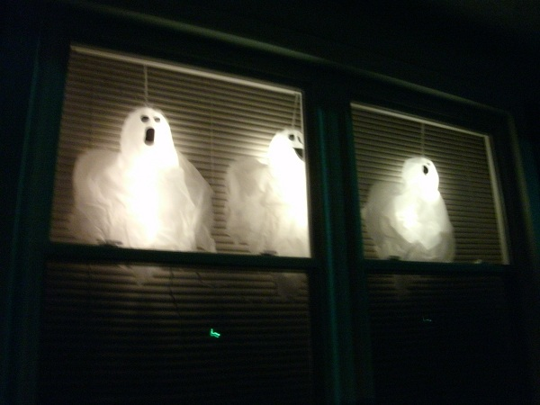 I also got these ghosts that light up in the yard. However after a few  minutes I realized these plug-in lights were not going to mix with the  weather. - Neko Random: My Halloween Stuff: Part 1