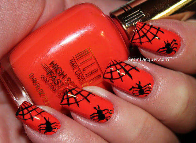 Halloween spiderweb and spider nail art