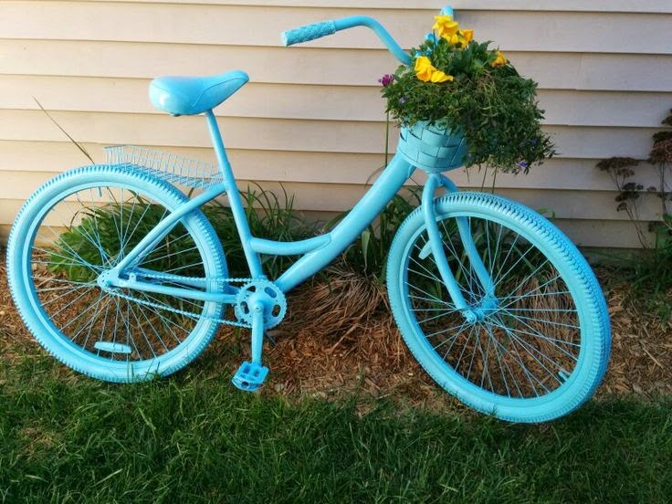 cruiser bike spray painted aqua with flowers in basket