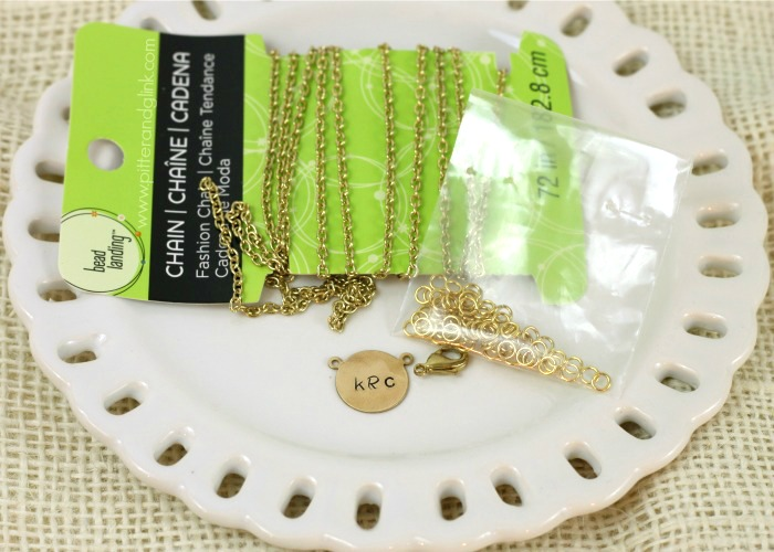 Add chain, jump rings and a clasp to a stamped metal blank to create a necklace. www.pitterandglink.com