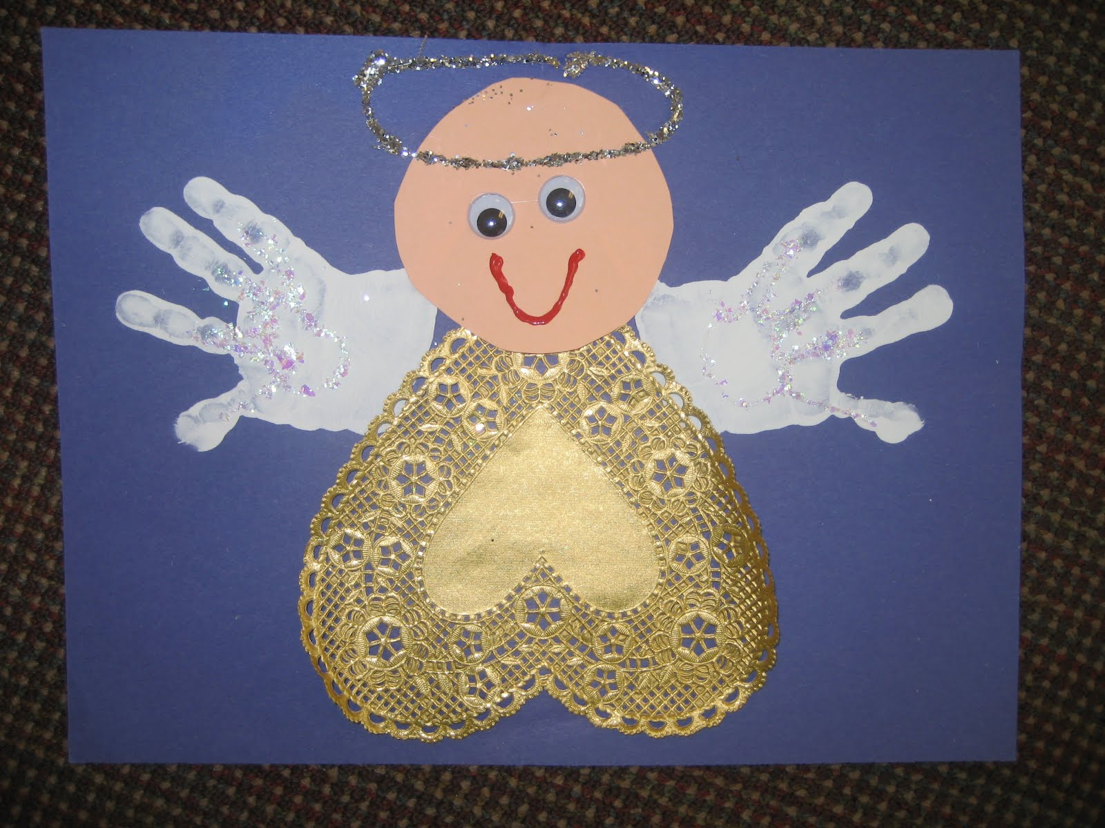 and added glitter for a glow the kids  pleted it with a glitter halo