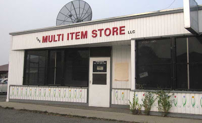 Vacant store front with plastic sign reading The Multiple Item Store LLC