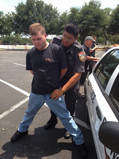 Luis Pedraza practices arrest procedures.