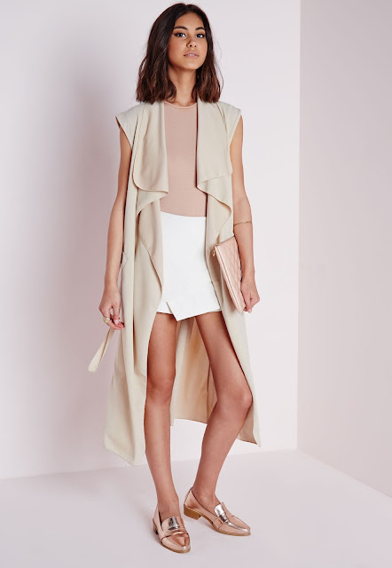 https://www.missguided.co.uk/clothing/category/coats-jackets/sleeveless-belted-waterfall-duster-camel
