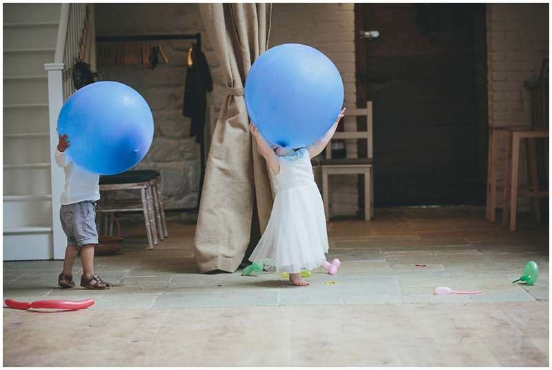Children playing with balloons at the Tithe Barn