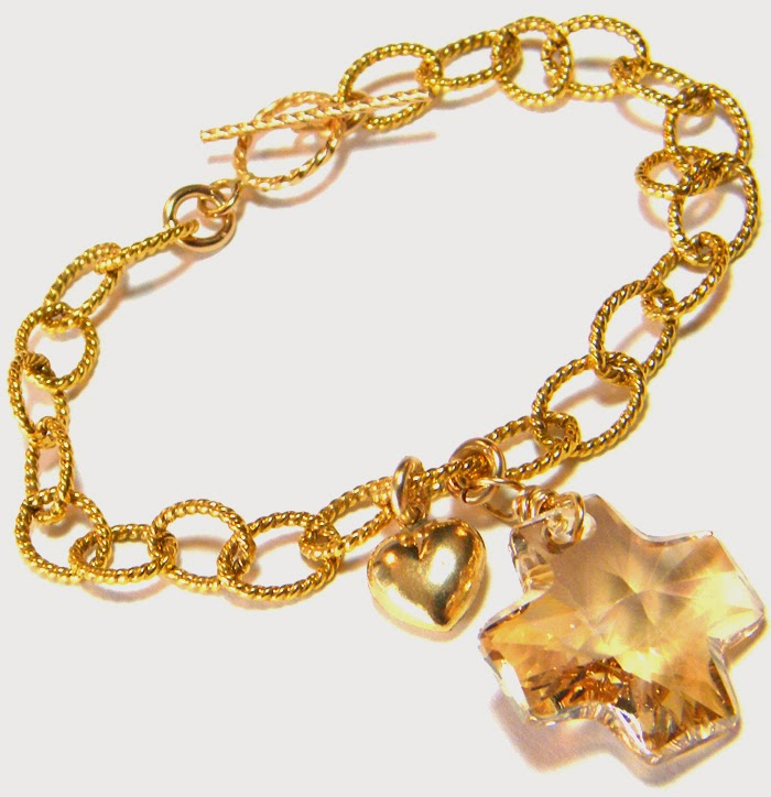 gold bracelet with Swarovski cross