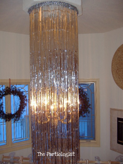 The partiologist silver christmas dinner party part ii i went to party city and bought three metallic fringe door curtains and hung them around my ceiling medallion covering the top with silver tinsel from hl aloadofball Images