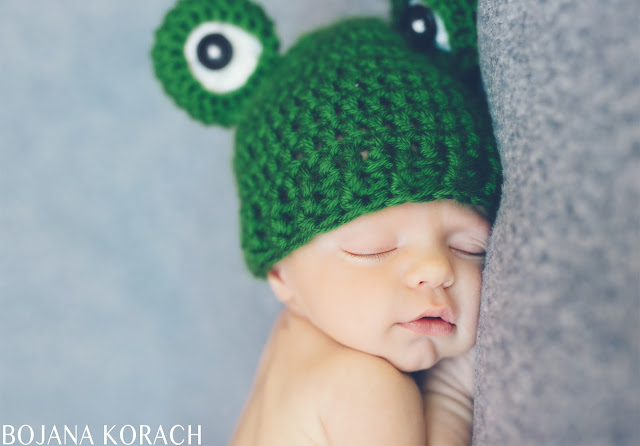 newborn baby boy photographed by bojana korach photography in san francisco bay area wearing a green frog hat