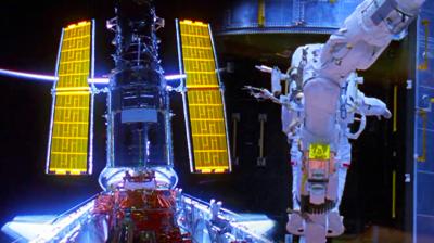 Atlantis – STS135 – Crew of Atlantis repairing Hubble Telescope in 2009. NASA-TV 2011.