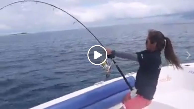 How to fish girl catch big fish feeling excited for How to catch a fish