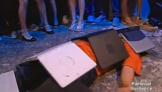 Instead of newspapers covering the victim, the crowd used old laptops.