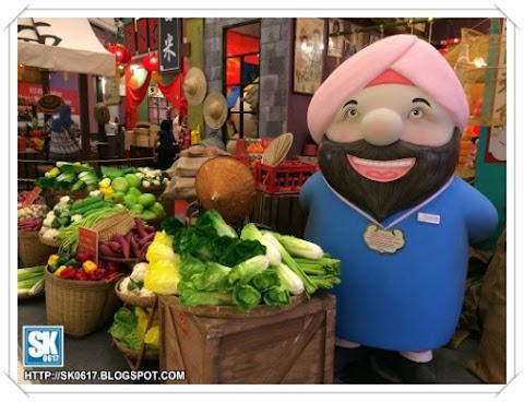 Veggie seller at Nu Sentral CNY decorations