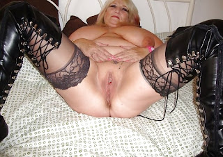 older lady spreading her legs wide so show her pussy