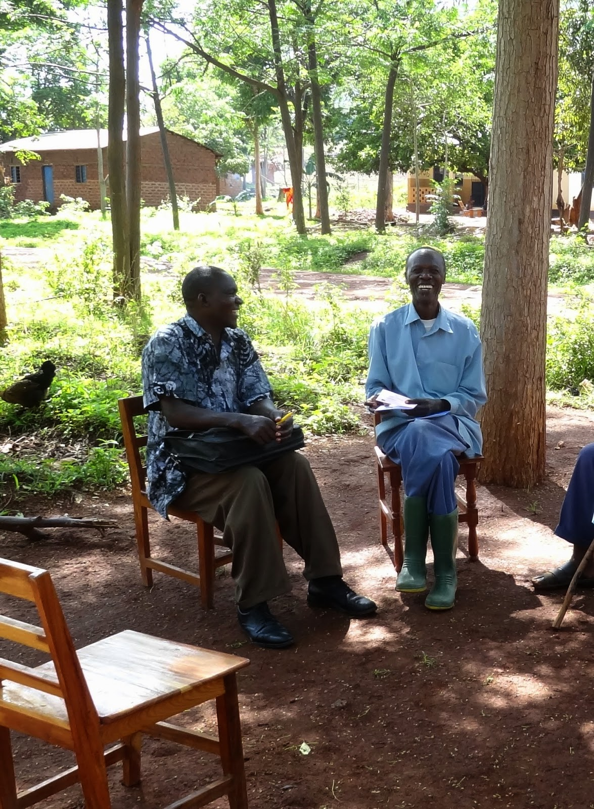 Jita men enjoying a moment in the shade